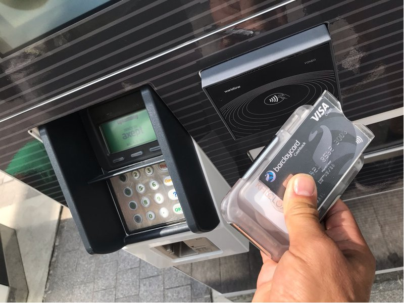 RFID Cloaked wallet being used at a contactless transport terminal, The Ultimate Wallet with RFID Protection, photo