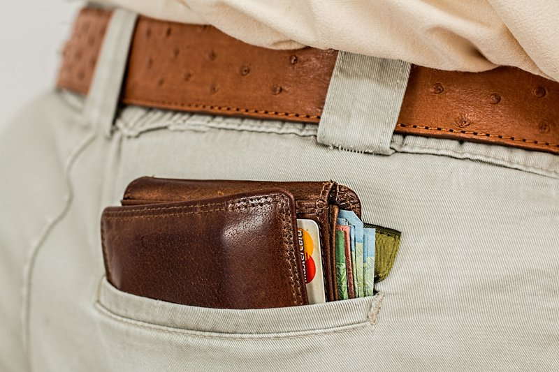Bulging wallet sticking out of back pocket perfect for pickpockets
