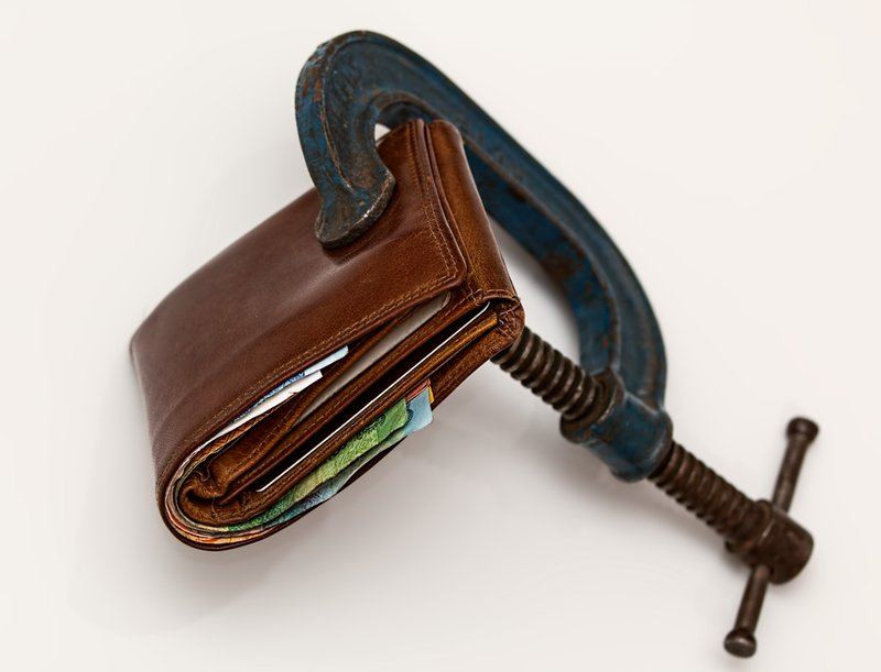 Traveller wallet stuffed with cash and clamped to keep secure but is it?